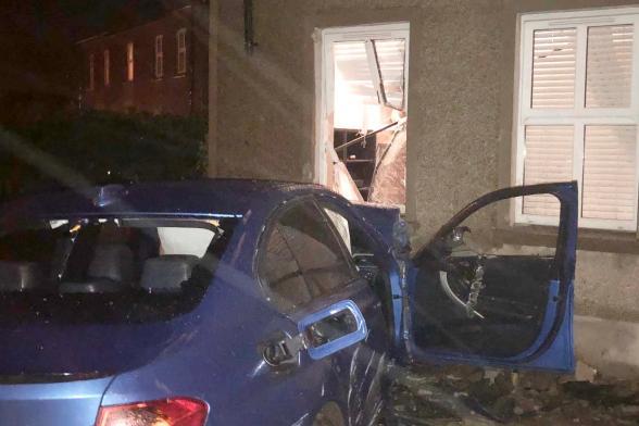 Car crashes into living room